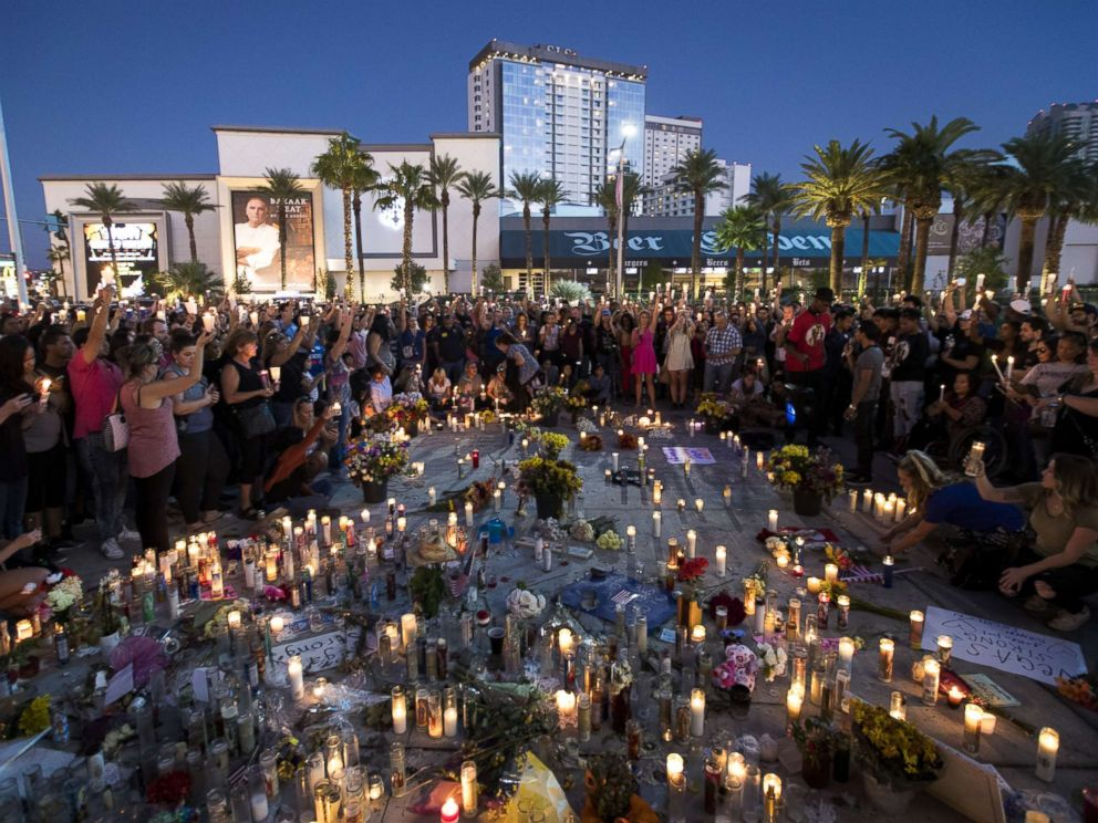 Hundreds gather in a moment of silence on October 8 following the mass shooting