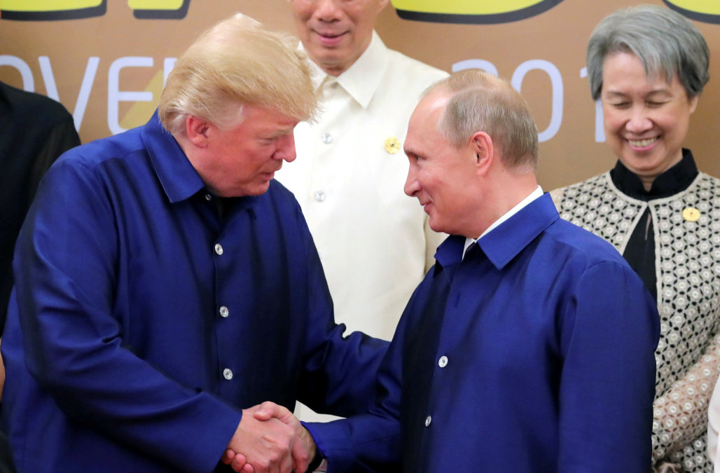 U.S. President Donald Trump and Russian President Vladimir Putin shake hands as they take part in a family photo at the APEC summit in Danang, Vietnam November 10, 2017. Sputnik/Mikhail Klimentyev/Kremlin via REUTERS ATTENTION EDITORS - THIS IMAGE WAS PROVIDED BY A THIRD PARTY.